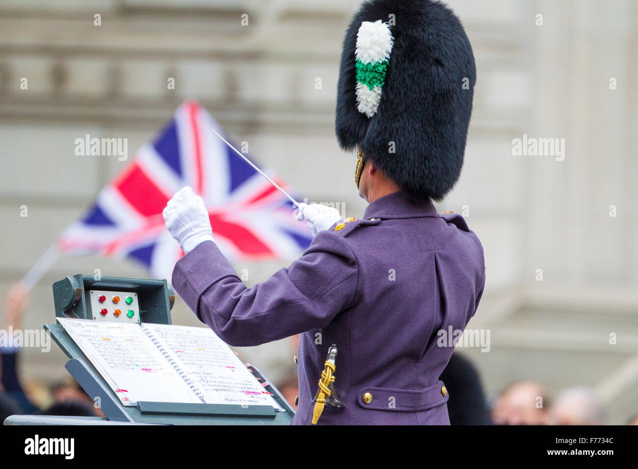 The Senior Director of Music, Lieutenant Colonel Kevin Roberts, conducting during the Cenotaph Ceremony 2015 - Stock Image