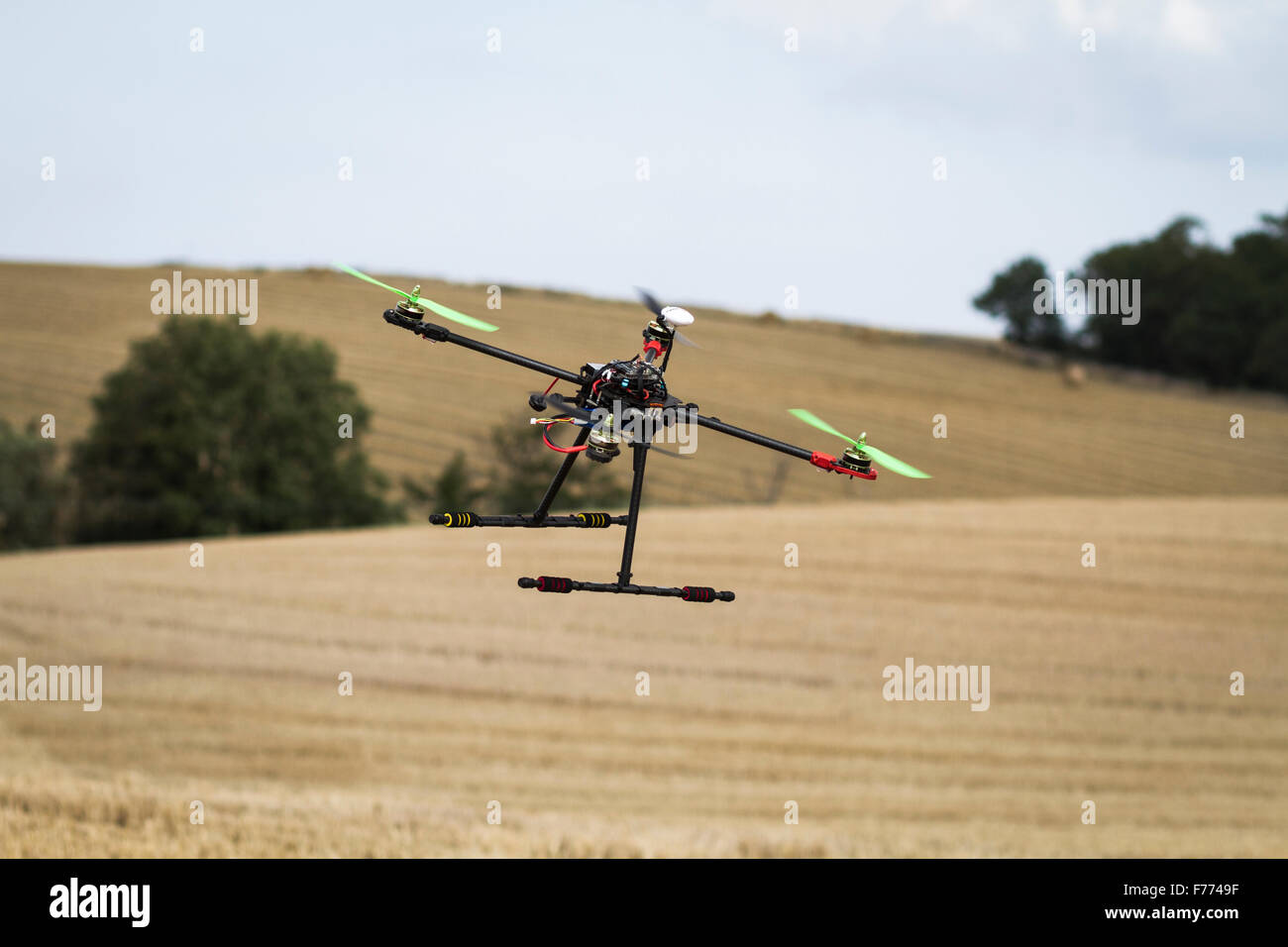 Quadcopter in flight - Stock Image