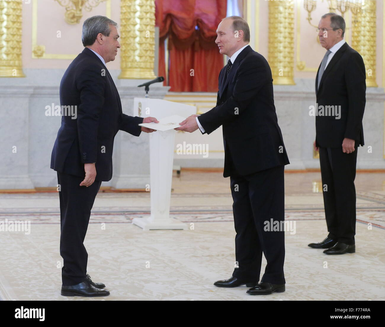 Moscow, Russia. 26th Nov, 2015. Russia's president Vladimir Putin (C) receives the credentials from Palestine'sStock Photo