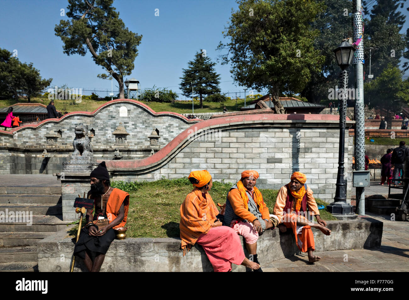 sadhus resting and chatting at Pashupatinath temple complex in Kathmandu, Nepal - Stock Image