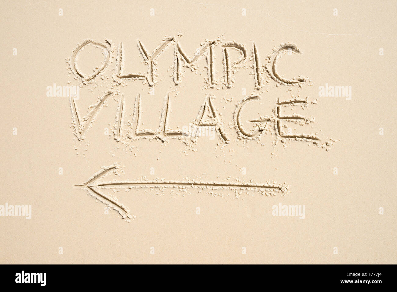 RIO DE JANEIRO, BRAZIL - NOVEMBER 10, 2015: Handwritten message with arrow pointing the way to Olympic Village written - Stock Image