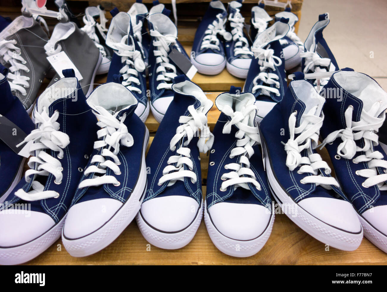 A lots of converse shoes in store - Stock Image