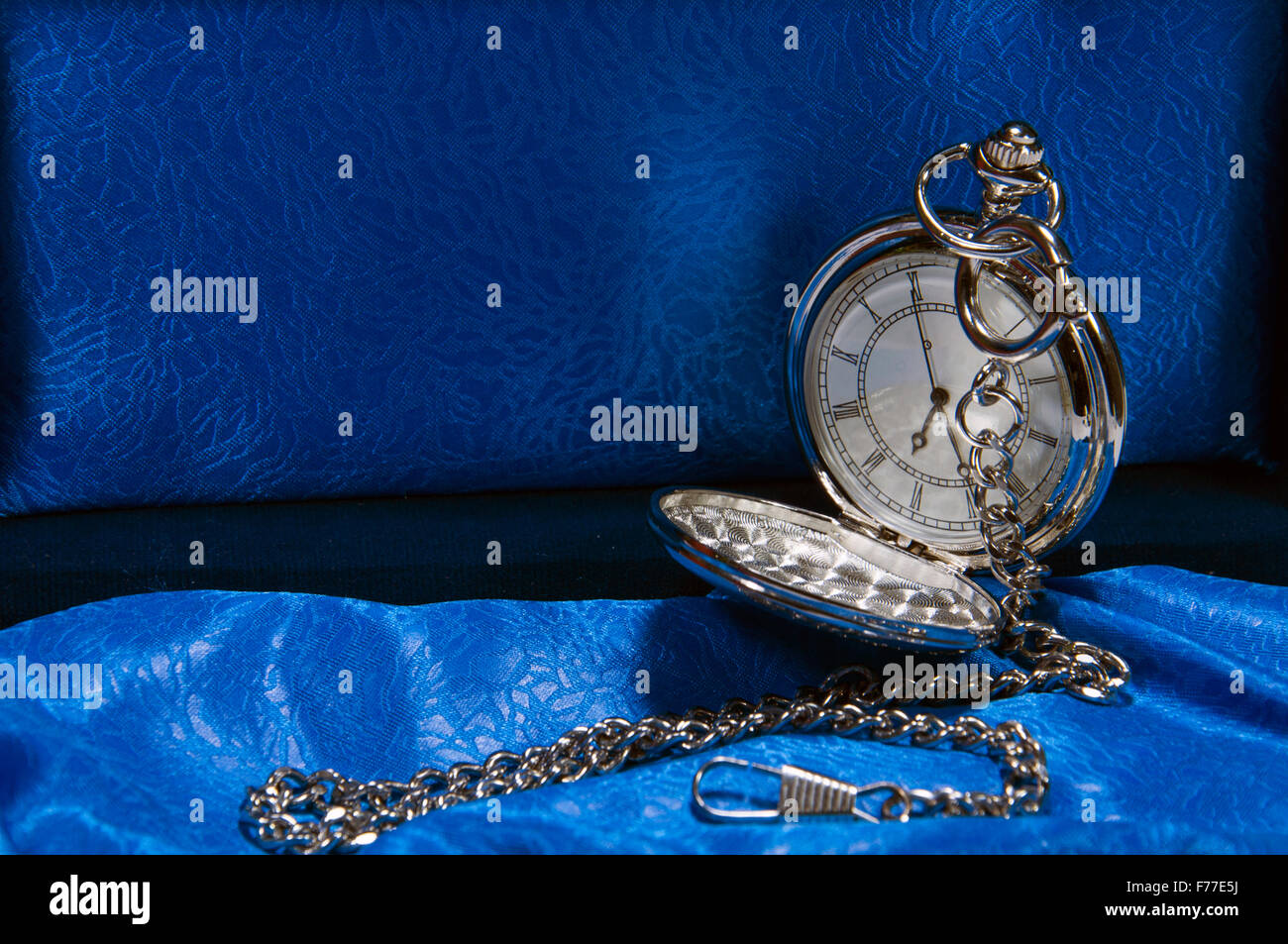 Vintage pocket watch and hour glass or sand timer, symbols of time with copy space - Stock Image