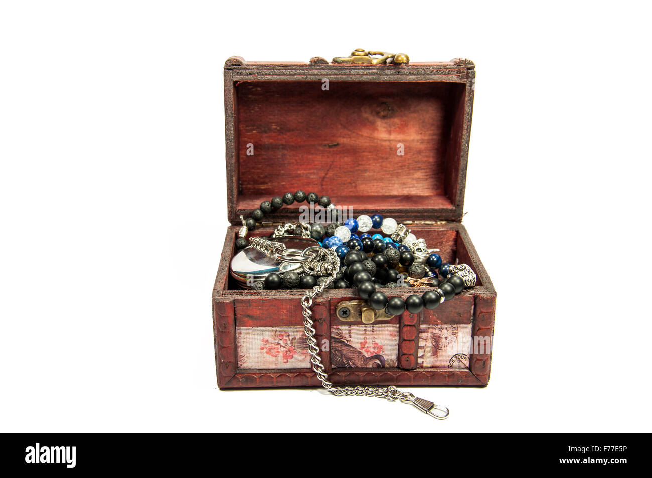 A wooden treasure chest filled with loot. - Stock Image