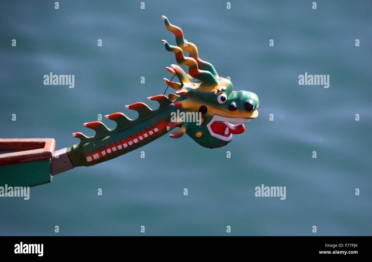 Dragon Boat Racing Figure Head St Helier Harbour Jersey Channel Islands - Stock Image