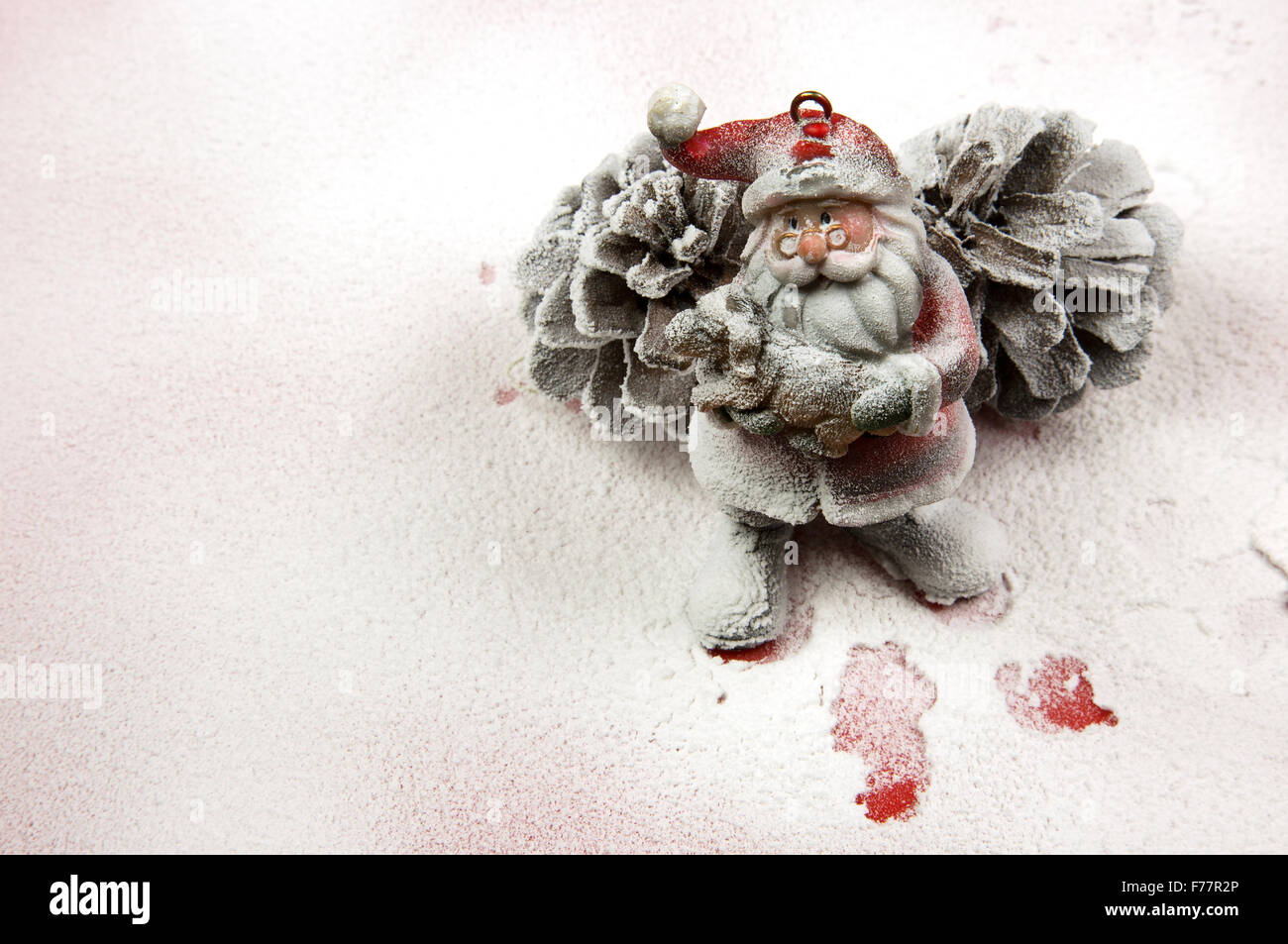 Christmas Decorationsanta Claus Figurine Based On Two Large Spruce Cones On Snow Covered Red Surface And In The Footsteps Of S