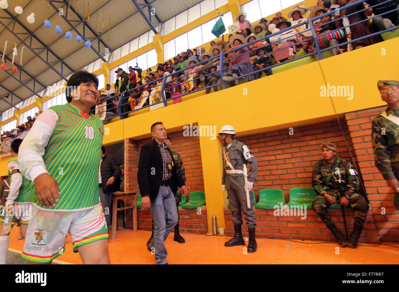 Oruro, Bolivia. 26th Nov, 2015. Bolivia's President Evo Morales (L) takes part in a soccer match during the handover Stock Photo