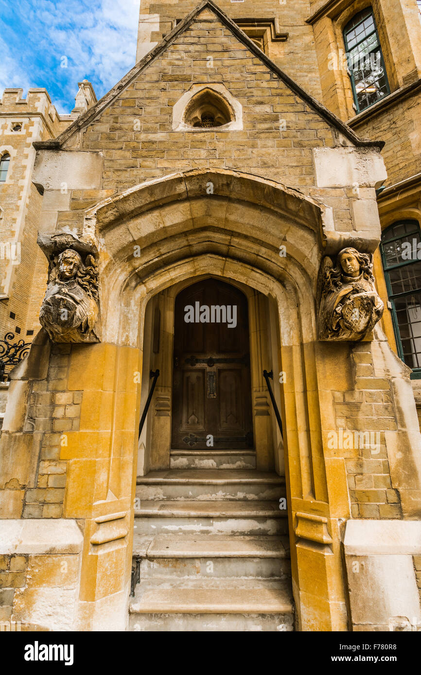 Old stone entrance decorated with angels , London, Uk from an old building near Westmister - Stock Image