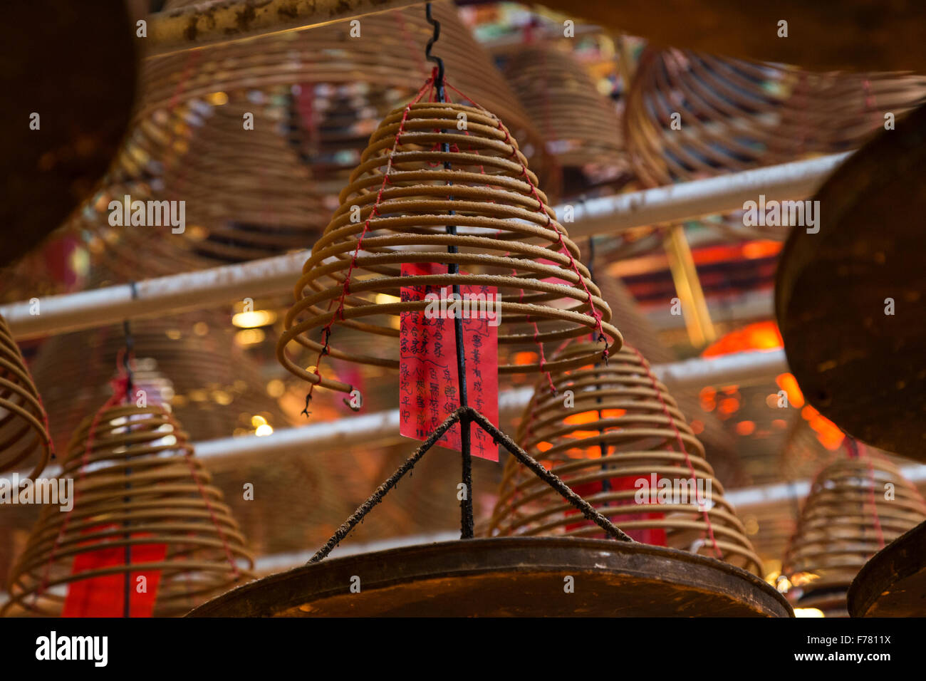 Incense cones at the Man Mo Temple in Sheung Wan, Hong Kong, China. Focused on one coil. - Stock Image