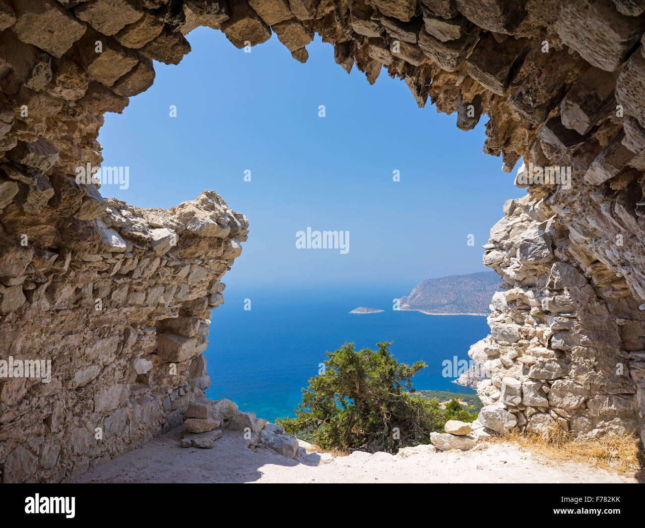 View out through the remains of Monolithos Castle on the Greek Island of Rhodes Dodecanese Greece Europe - Stock Image