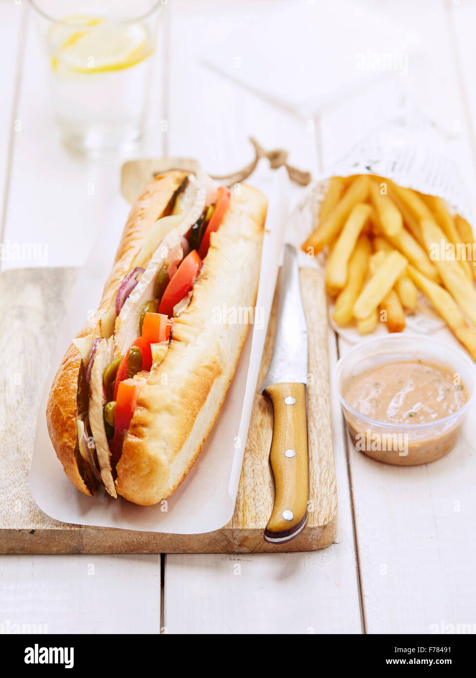 Bocadillo with chicken and pickles - Stock Image