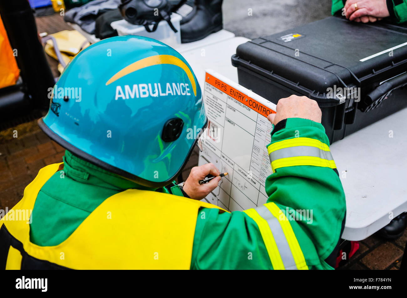 Northern Ireland. 26th November, 2015. An incident officer with the Northern Ireland Ambulance Service updates a - Stock Image