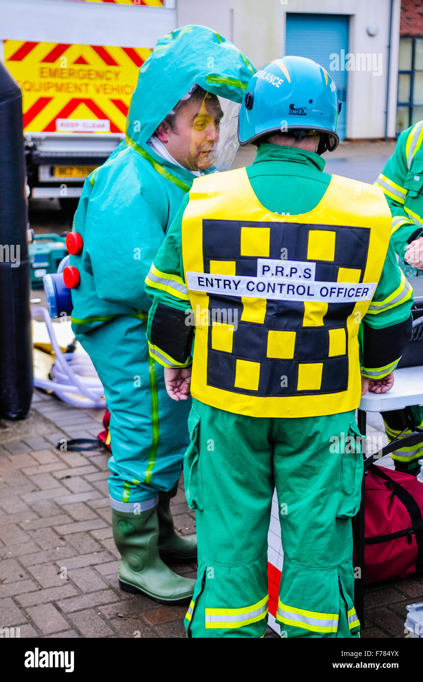 Northern Ireland. 26th November, 2015. A paramedic wearing a Respirex Powered Respirator Protective Suit (PRPS), - Stock Image