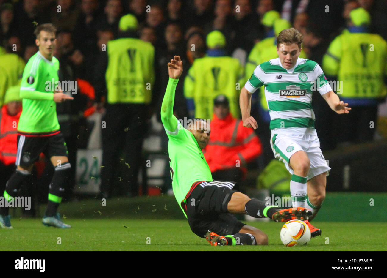 Glasgow, Scotland. 26th Nov, 2015. Europa League. Celtic versus Ajax. James Forrest is tackled by Kenny Tete Credit: - Stock Image