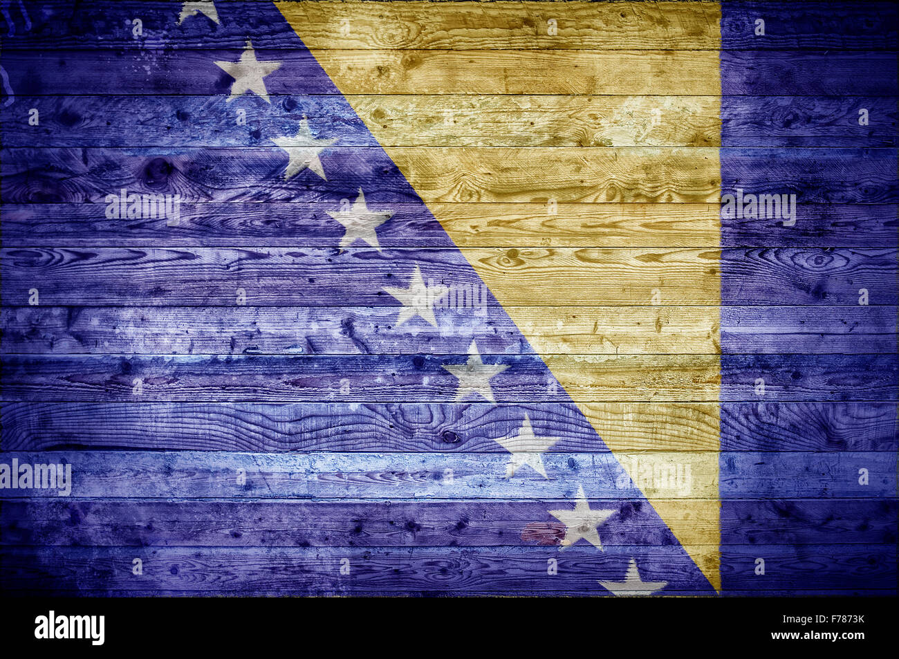 A vignetted background image of the flag of Bosnia and Herzegovina painted onto wooden boards of a wall or floor. - Stock Image