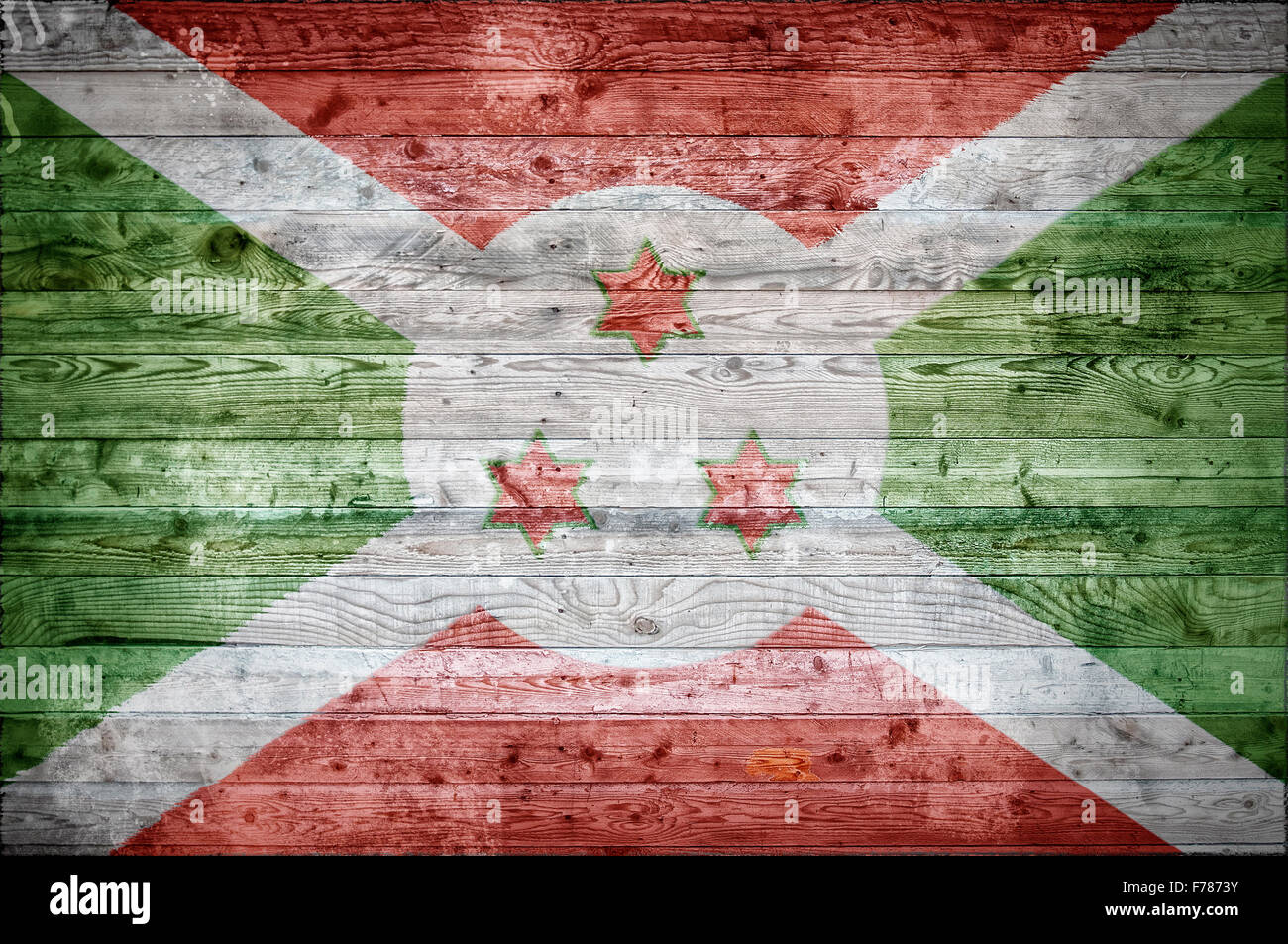 A vignetted background image of the flag of Burundi painted onto wooden boards of a wall or floor. - Stock Image
