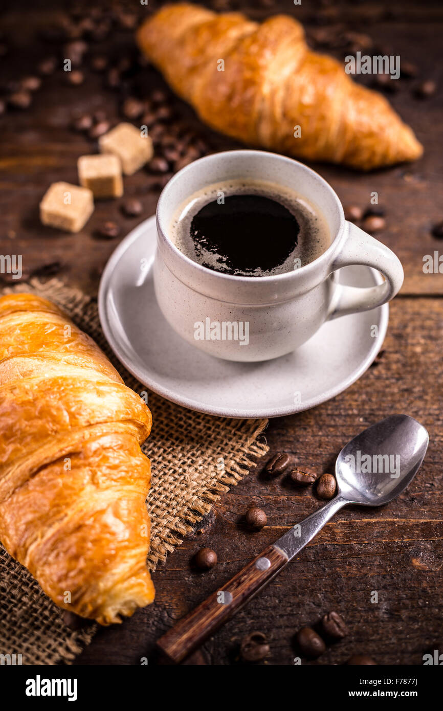 Croissant and coffee on vintage style - Stock Image