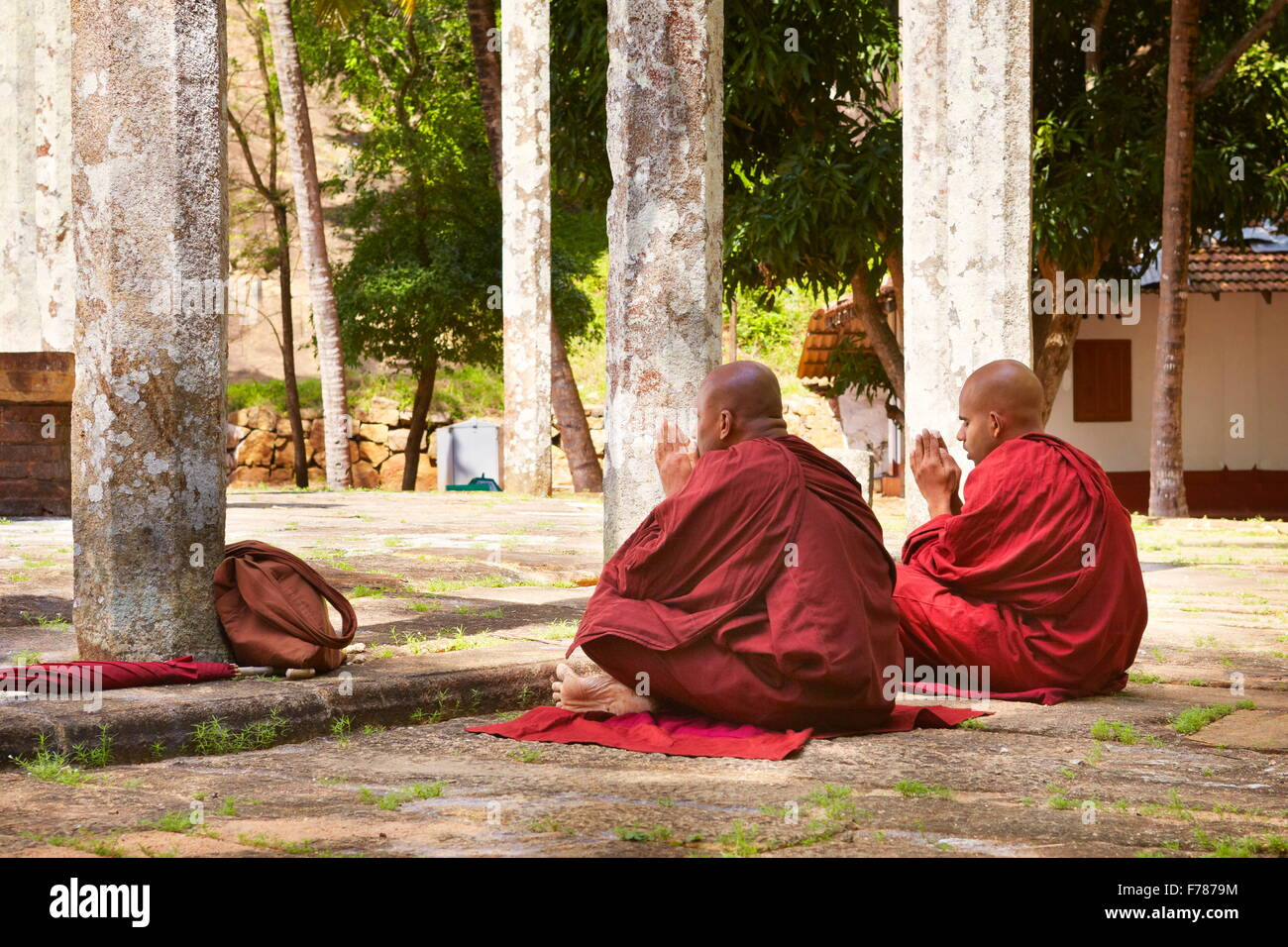 Sri Lanka - monks praying at Mihintale Temple, Ambasthale Dagoba, UNESCO - Stock Image