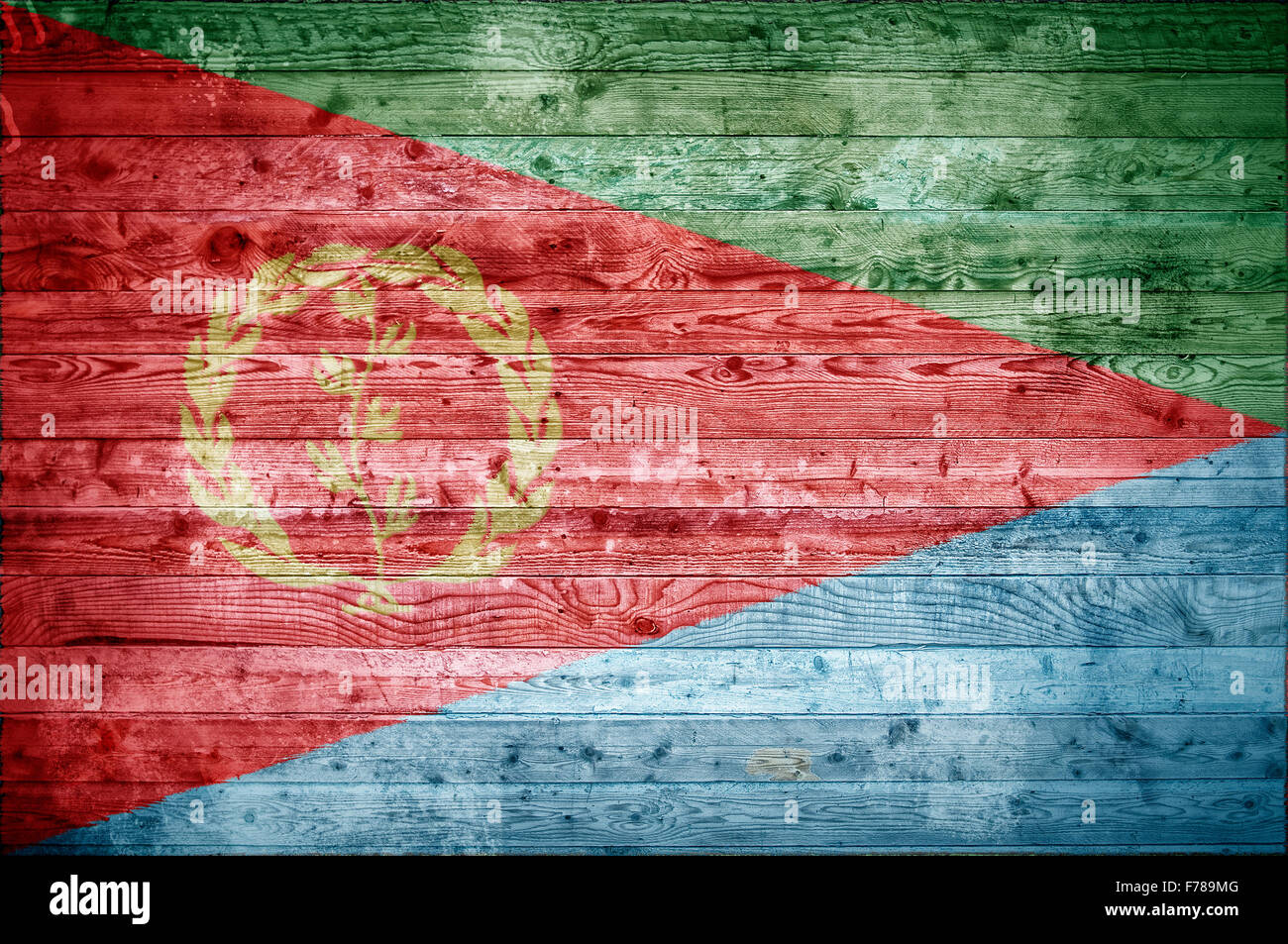 A vignetted background image of the flag of Eritrea painted onto wooden boards of a wall or floor. - Stock Image