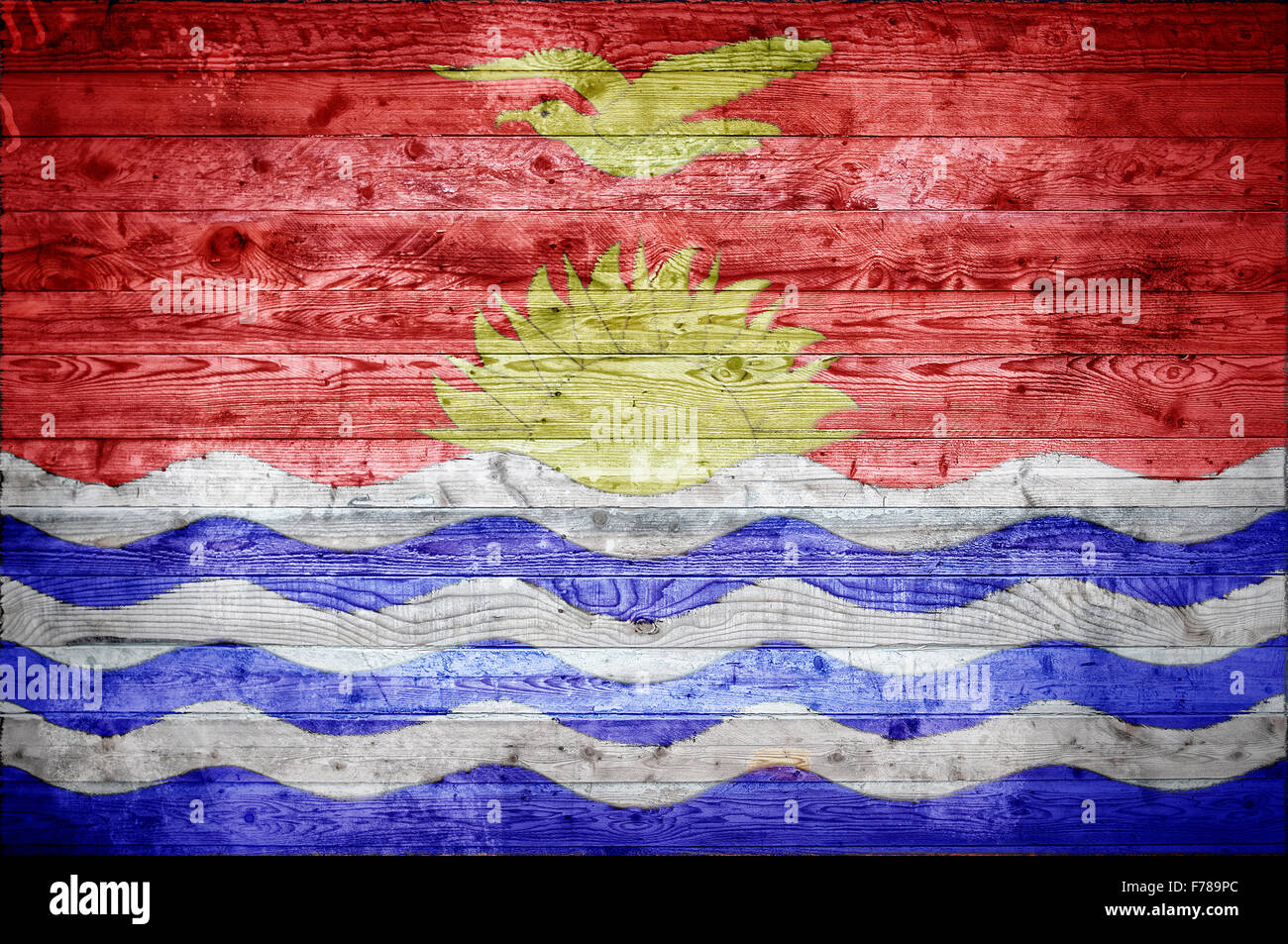 A vignetted background image of the flag of Kiribati painted onto wooden boards of a wall or floor. - Stock Image