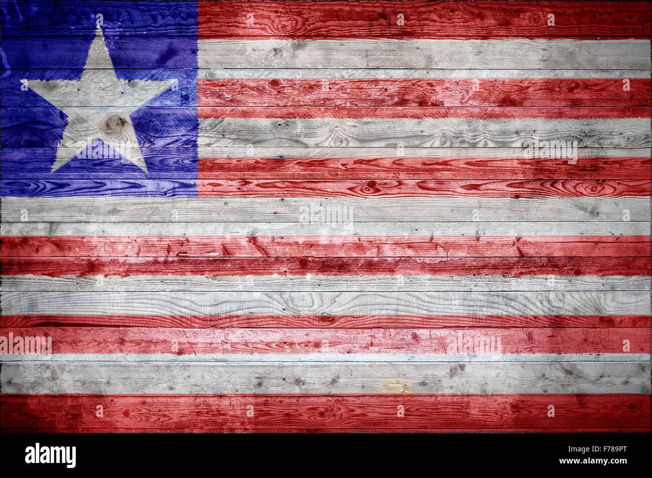 A vignetted background image of the flag of Liberia painted onto wooden boards of a wall or floor. - Stock Image