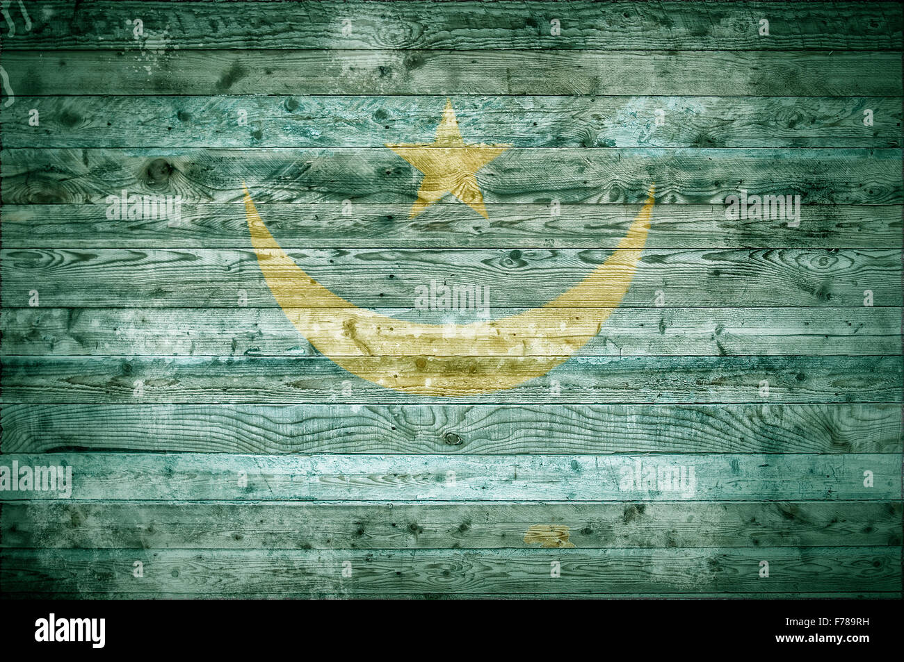 A vignetted background image of the flag of Mauritania painted onto wooden boards of a wall or floor. - Stock Image