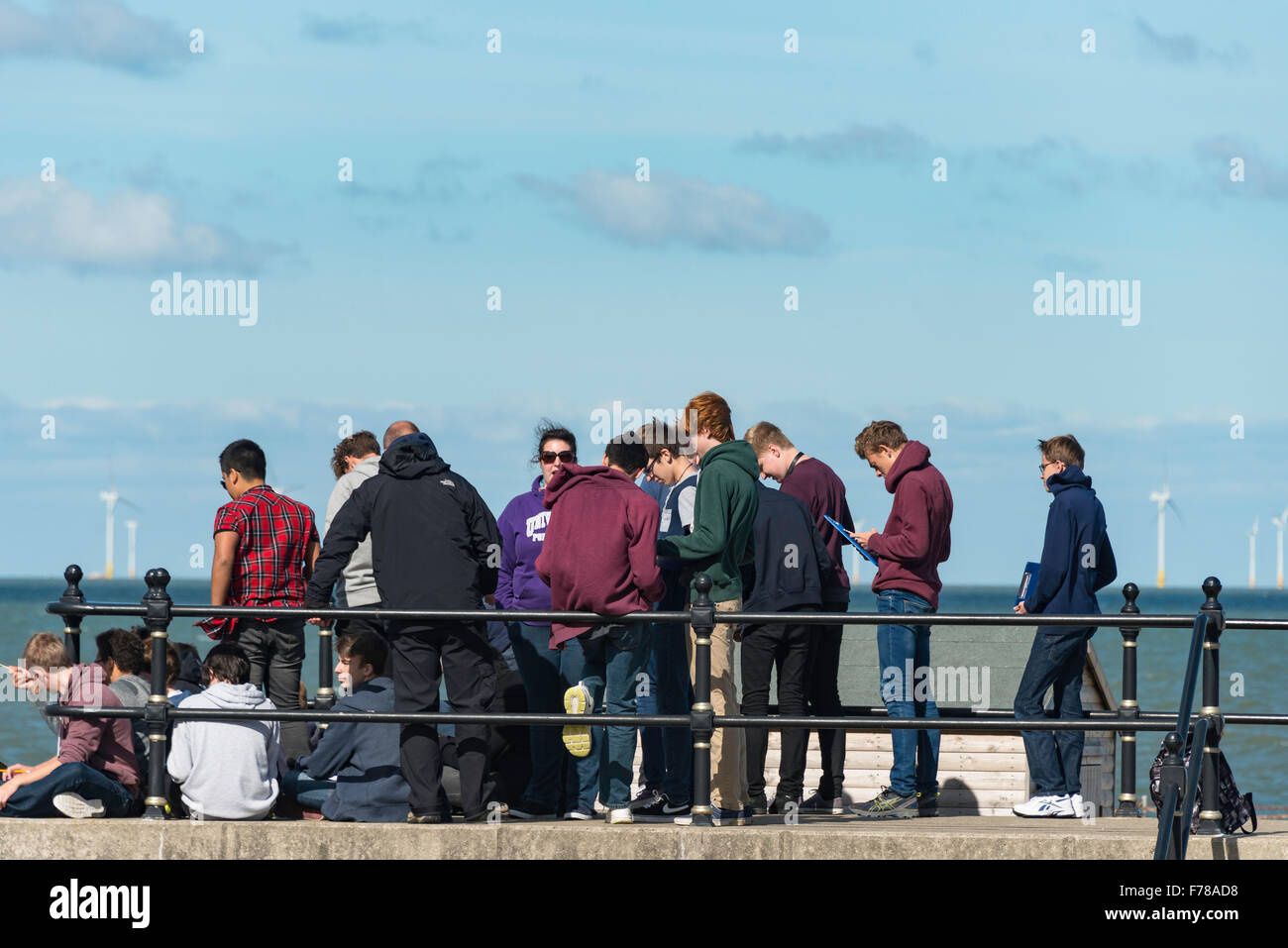 Student group on foreshore study trip, Herne Bay, Kent, England, United Kingdom - Stock Image