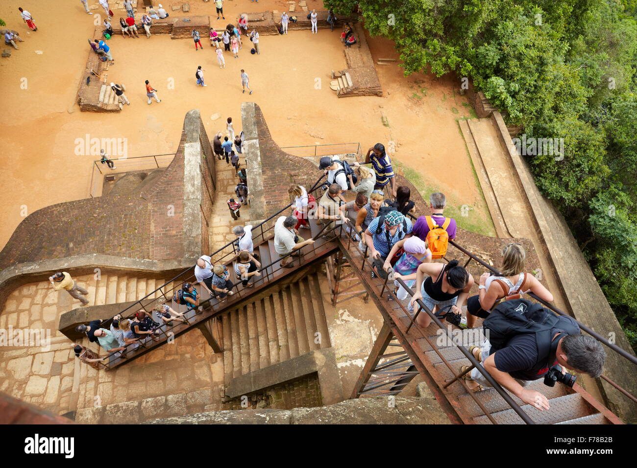 Sri Lanka - Sigiriya, tourists on the Lion's Gate to the ancient fortress, UNESCO - Stock Image