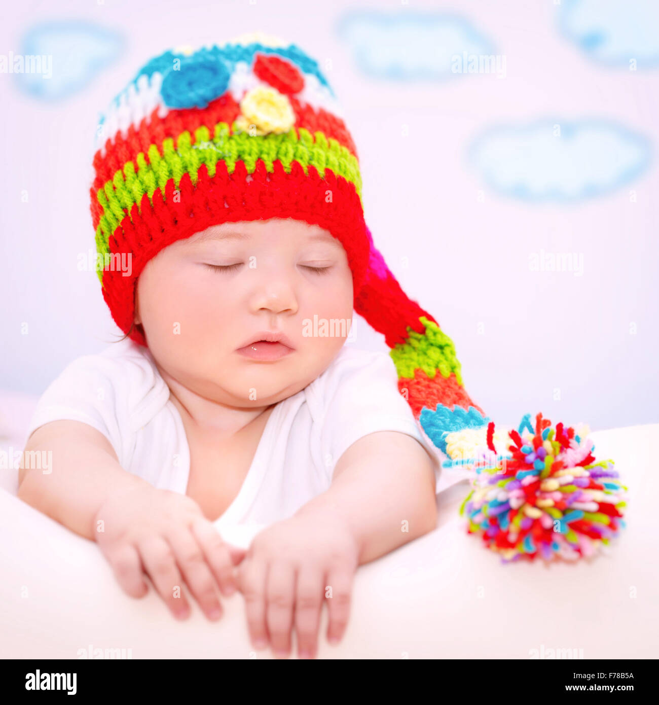 portrait of cute sweet baby girl with closed eyes relaxing on the