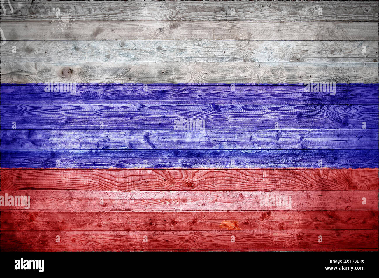 A vignetted background image of the flag of Russian Federation onto wooden boards of a wall or floor. - Stock Image