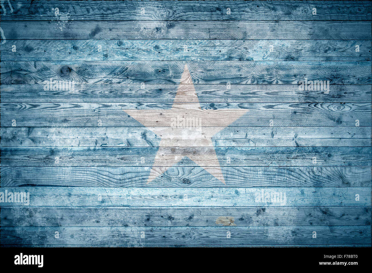 A vignetted background image of the flag of Somalia onto wooden boards of a wall or floor. - Stock Image