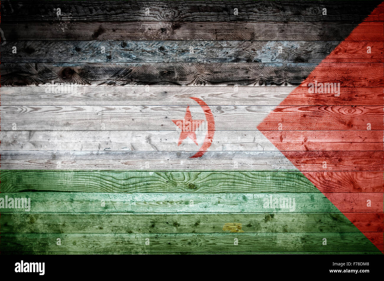 A vignetted background image of the flag of Western Sahara onto wooden boards of a wall or floor. - Stock Image