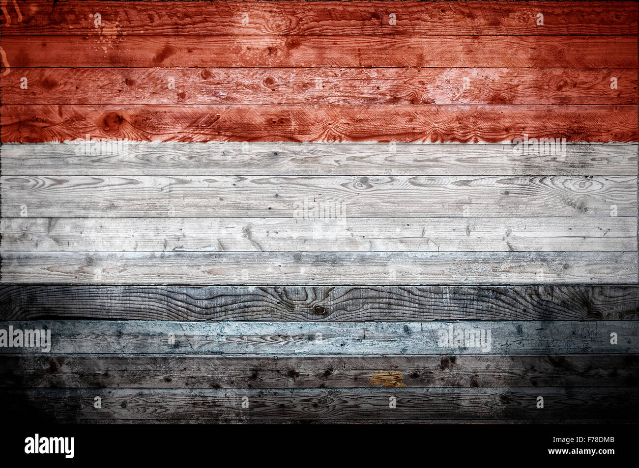 A vignetted background image of the flag of Yemen onto wooden boards of a wall or floor. Stock Photo