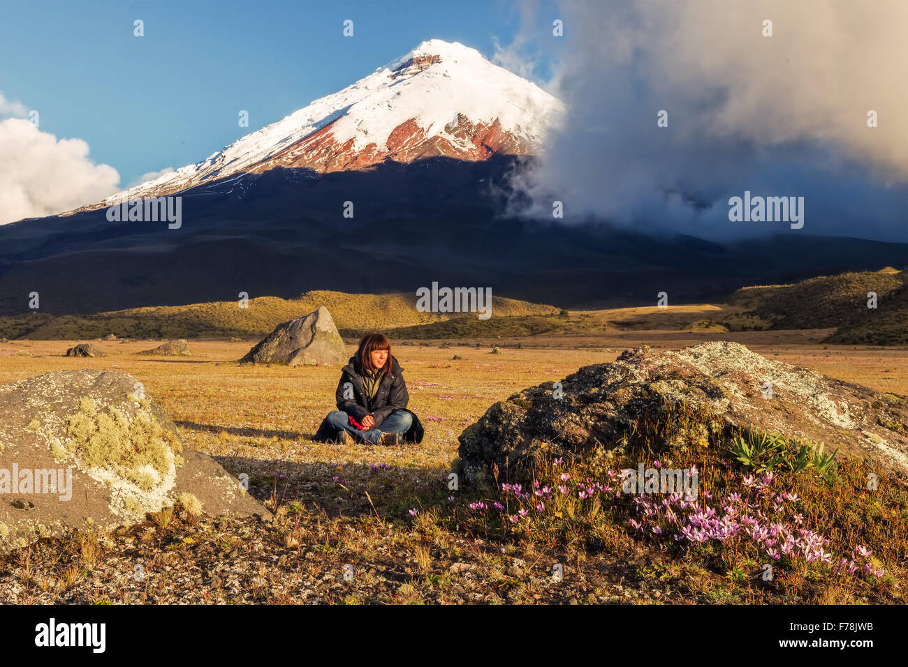 Young Volcanologist At The Foot Of Cotopaxi Volcano, South America - Stock Image