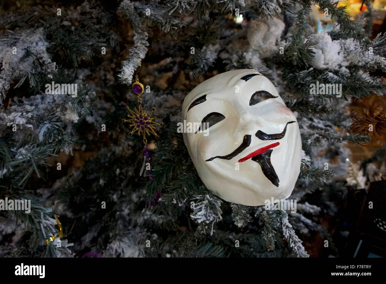 Theatrical mask decoration on Christmas Tree - Stock Image