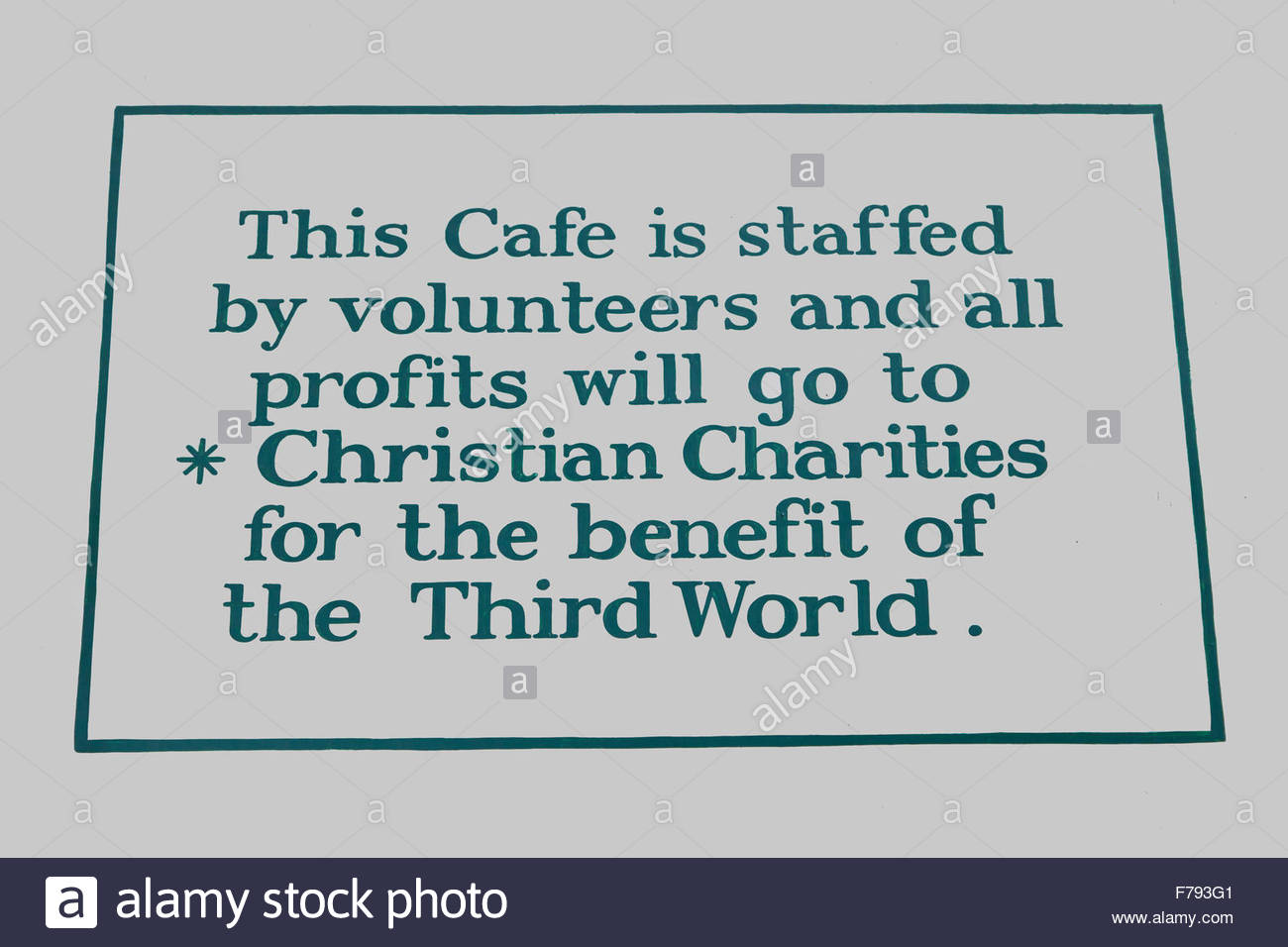 Sign over the door of The Cottage Cafe in Torquay Devon UK, which gives its profits to Christian Charities for the - Stock Image
