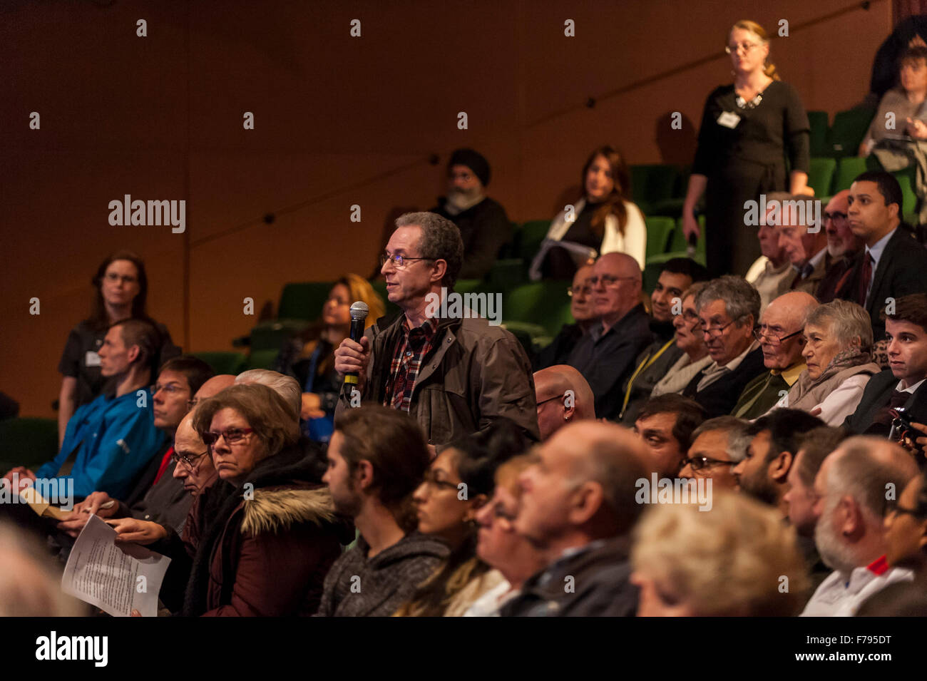 London, UK.  26 November 2015.  A member of the public asks a question during People's Question Time, at the - Stock Image