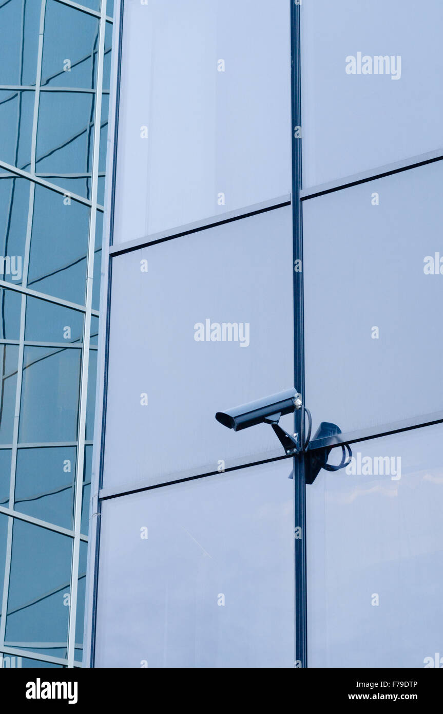 Outdoor surveillance camera on the wall of modern building - Stock Image