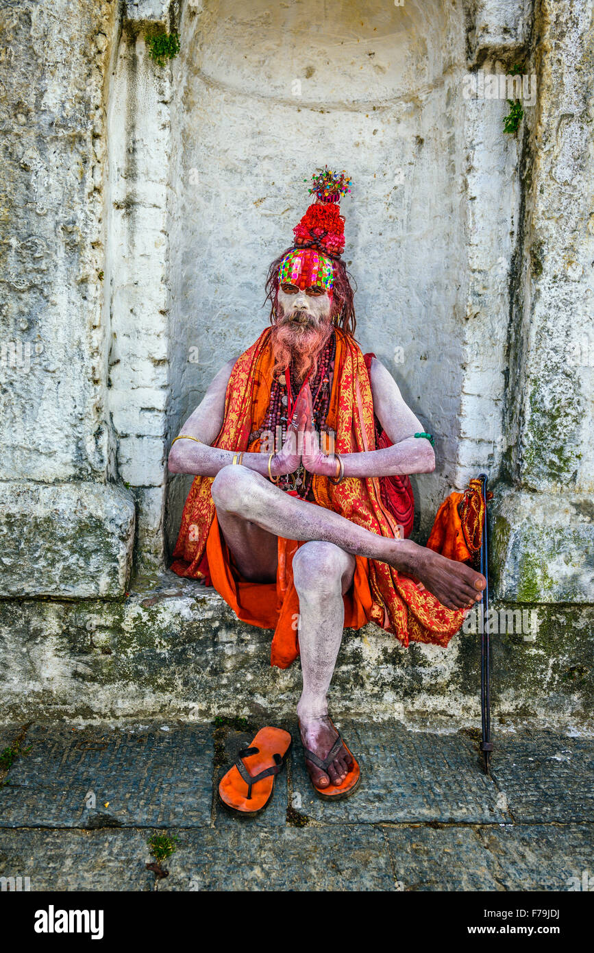Wandering  Shaiva sadhu (holy man) with traditional face painting in ancient Pashupatinath Temple - Stock Image