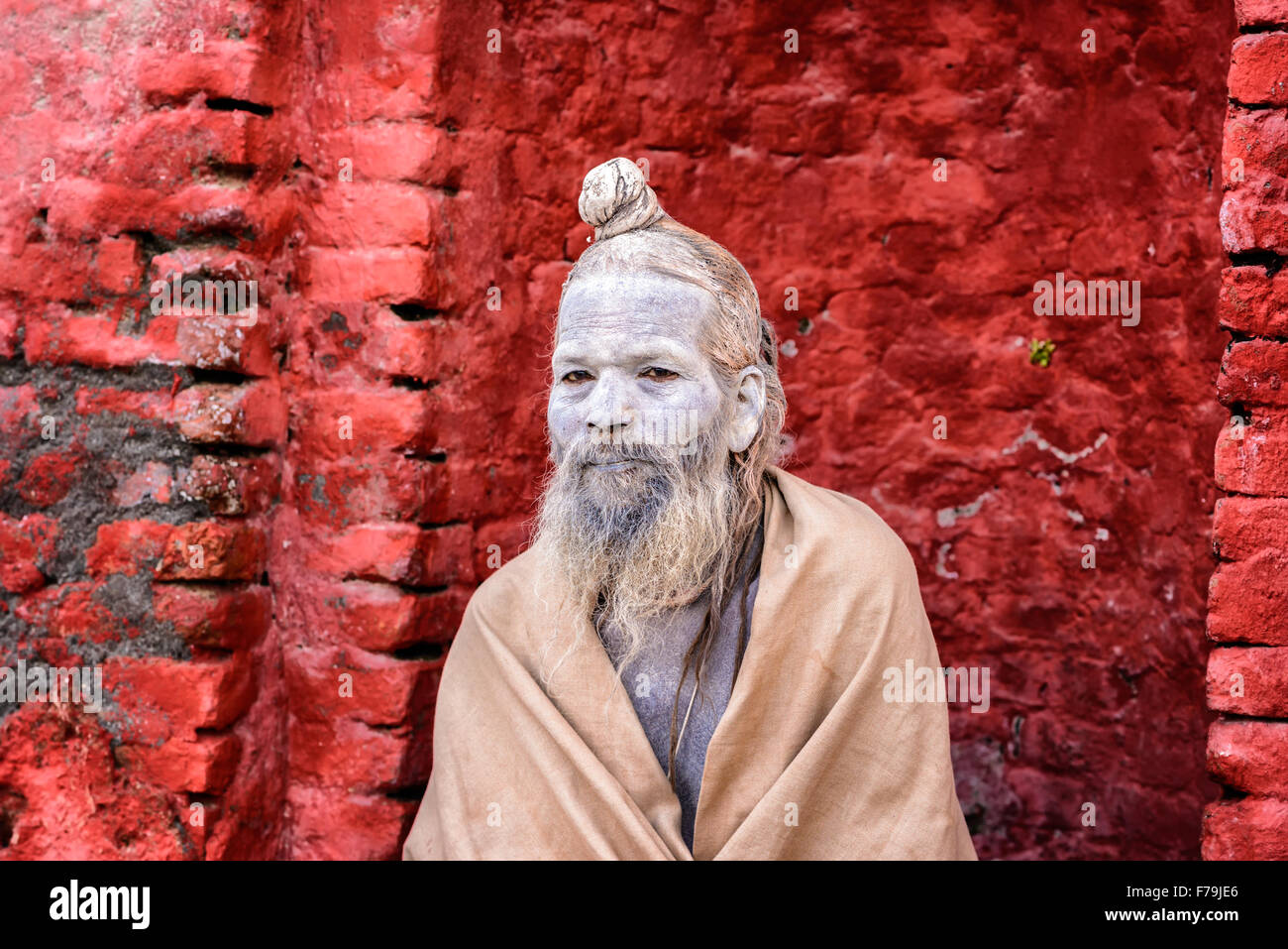 Wandering  Shaiva sadhu (holy man) with traditional face painting in ancient Pashupatinath Temple Stock Photo