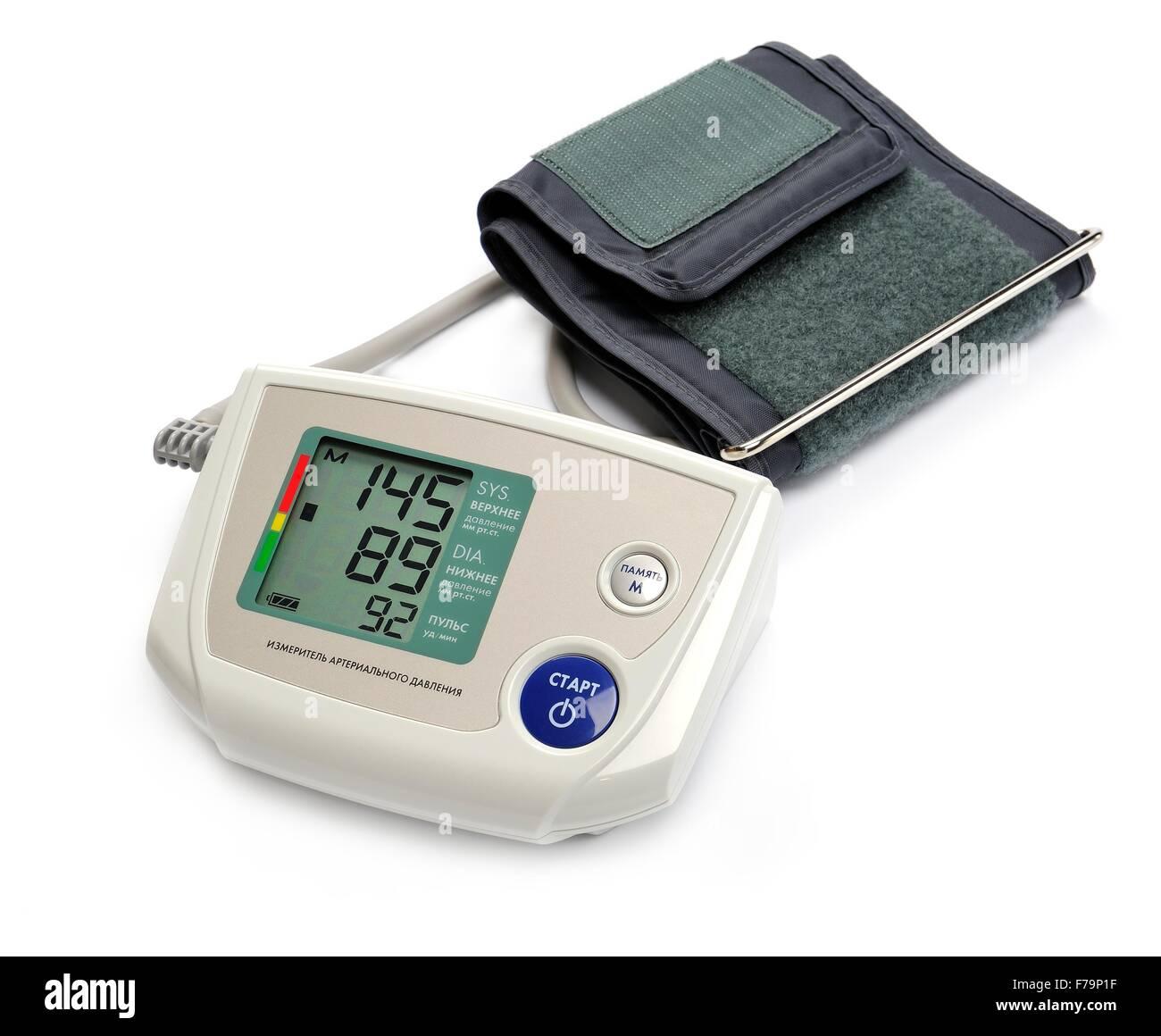 Tonometer - Digital blood pressure monitor on white background - Stock Image