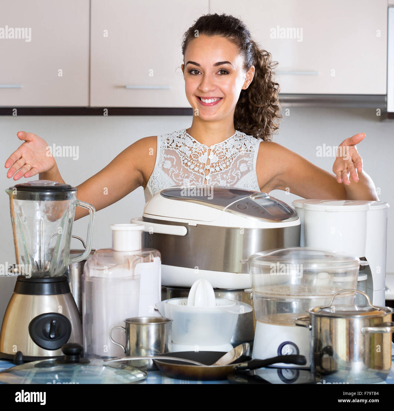 Happy Girl Posing With Appliances At Home Kitchen Stock Photo Alamy