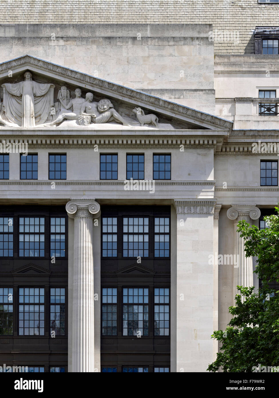 Pediment exterior of Victoria House, Bloomsbury, London, England, UK Stock Photo