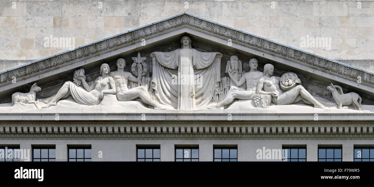 The decorated pediment exterior of Victoria House, Bloomsbury, London - Stock Image