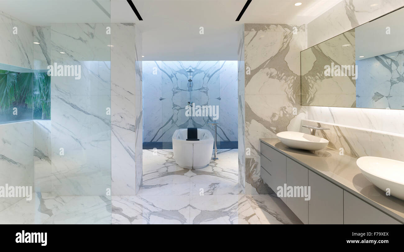 Freestanding bath in marble bathroom of Cove Way House, Sentosa ...