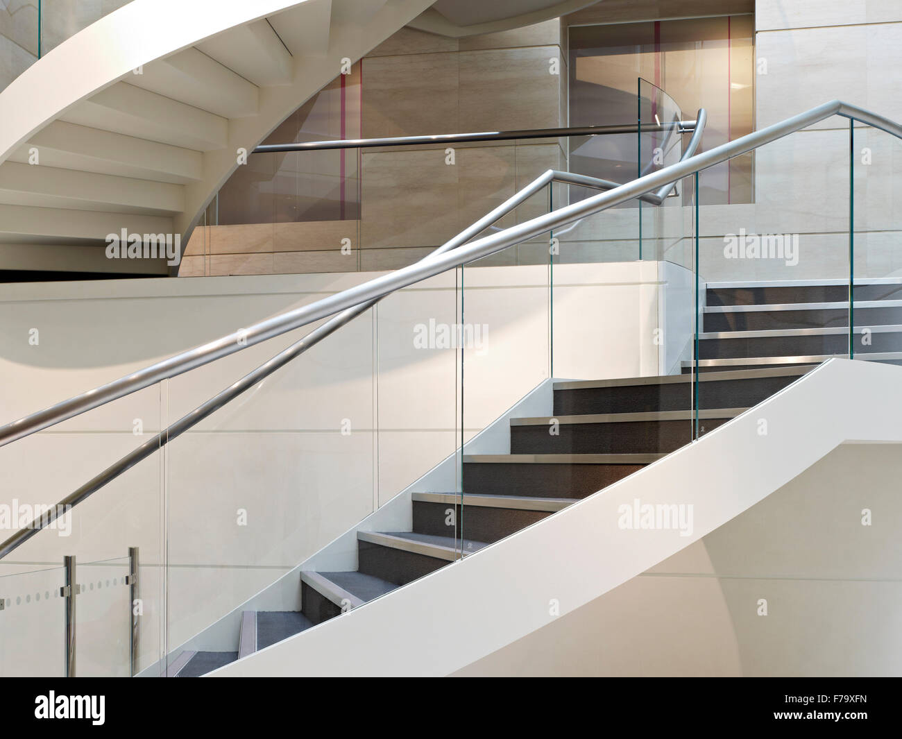 Metal handrail and staircase in Linklaters office headquarters building, London, England, UK - Stock Image