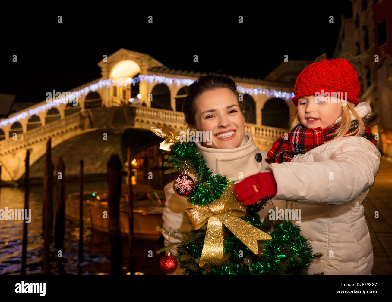 modern family take the best of christmas season by having a fascinating trip to venice italy happy mother and daughter with christmas tree in the front of - Modern Family Christmas