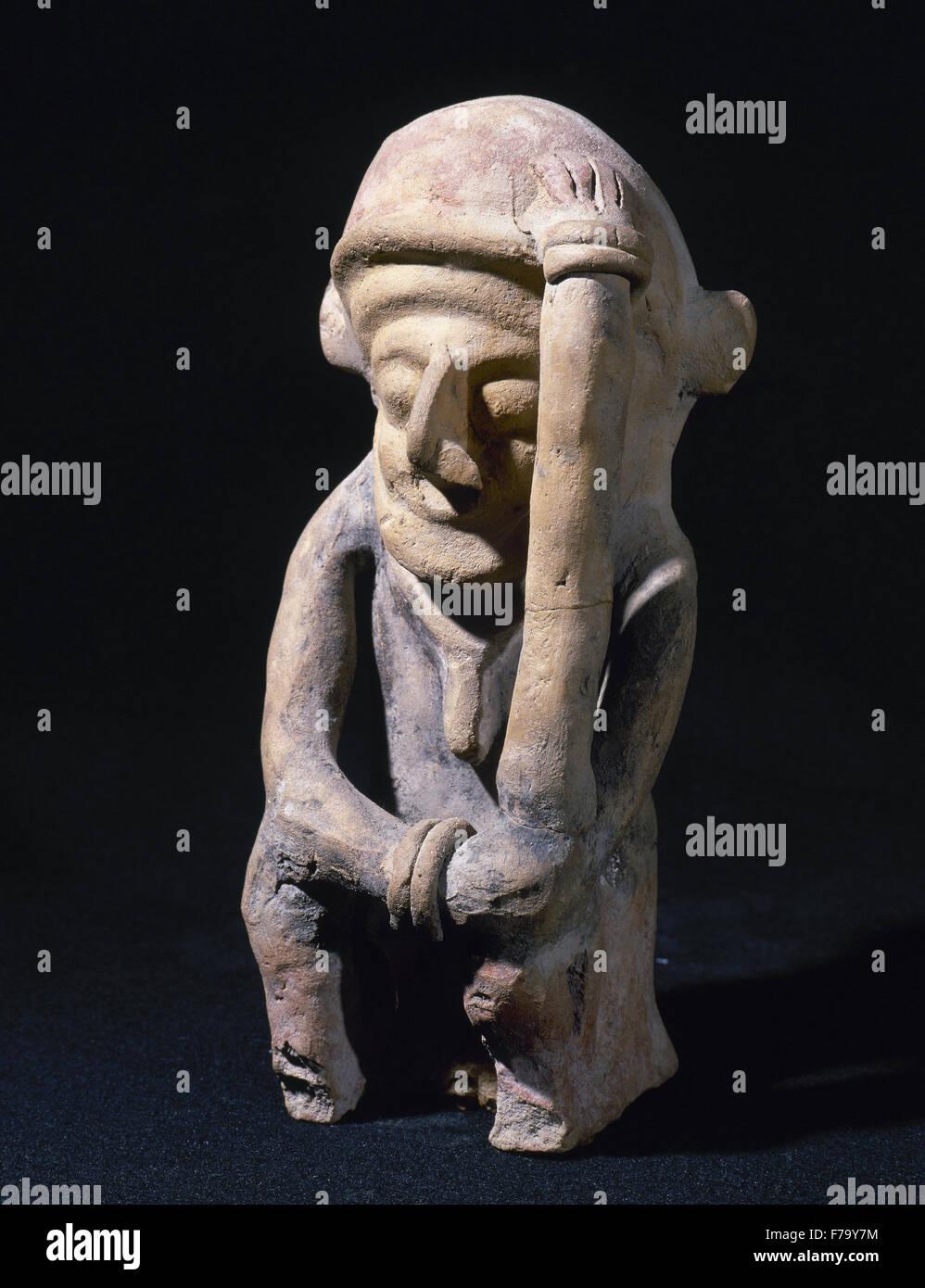 Bahia Culture (Mahia, Ecuador). 300 BC-500 AD. Male figure representing a thinker. 21 x 6,5 cm. From Ecuador. Period - Stock Image