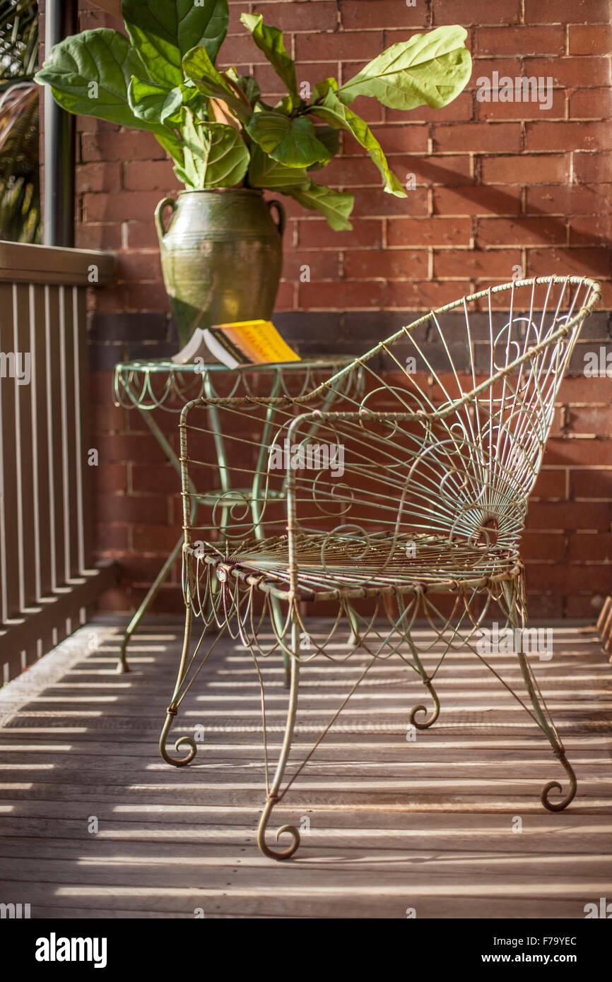 Vintage metal chair on balcony veranda of Sydney home of designer and Heritage Consultant Janine Hendry. - Stock Image