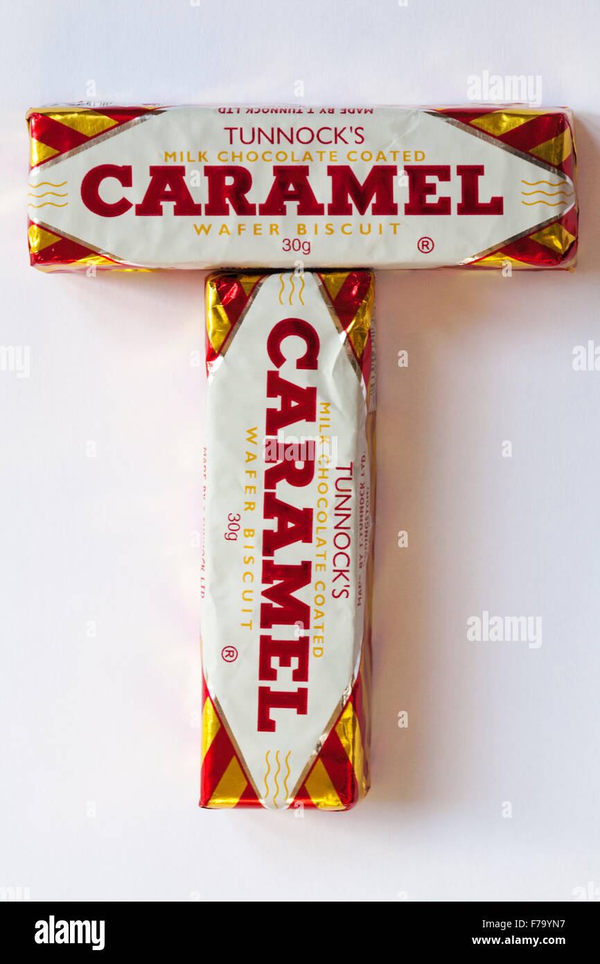 Two Tunnocks milk chocolate coated Caramel wafer biscuit arranged in T shape isolated on white background - Stock Image
